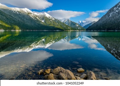 Chilliwack Lake with the reflecting Mount Redoubt, which is a part of the Skagit Range Mountains, and those are a sub-range of the Canadian Cascade Mountains. Chilliwack Lake Provincial Park, B.C.