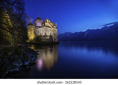 Chillon castle reflected on lake Geneva in the evening, Montreux, Switzerland
