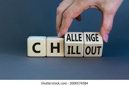Chillout or challenge symbol. Businessman turns the wooden cube and changes the word chillout to challenge. Beautiful grey background. Business and chillout or challenge concept. Copy space.