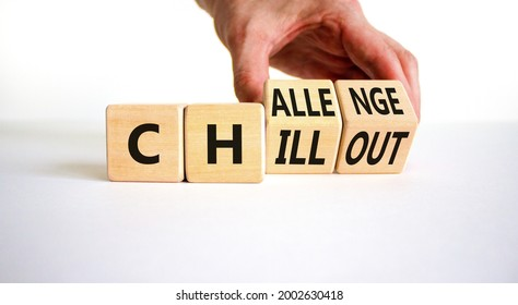 Chillout or challenge symbol. Businessman turns the wooden cube and changes the word chillout to challenge. Beautiful white background. Business and chillout or challenge concept. Copy space.