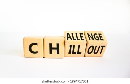 Chillout or challenge symbol. Turned the wooden cube and changed the word chillout to challenge. Beautiful white background. Business and chillout or challenge concept. Copy space.