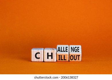 Chillout or challenge symbol. Turned the wooden cube and changed the word chillout to challenge. Beautiful orange background. Business and chillout or challenge concept. Copy space.