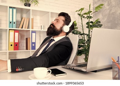 Chillout music for busy man. Business man listen to music in office. Bearded man wear modern headphones. Boss man enjoy work break. Career and professional life. Rest and relaxation.