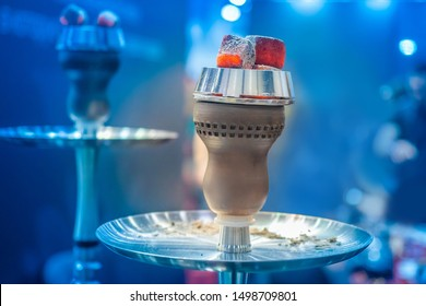 Chillum.  Coconut coals for hookah. Accessories for Hooka. Hot coals on bowls of hookahs.Hookah bar. Hot coal lie on a hooka stand. Charcoal for a hookah. Party with calabash.  Sale of hooka.