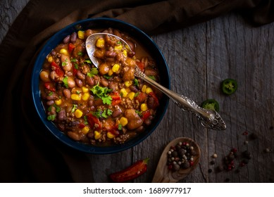 Chilly beans with hot peeper on dark background
