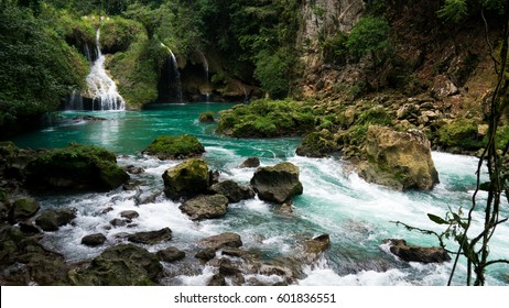The chilly natural pools drink greedily from a nearby waterfall and the waters flow delicately round the ancient rocks.