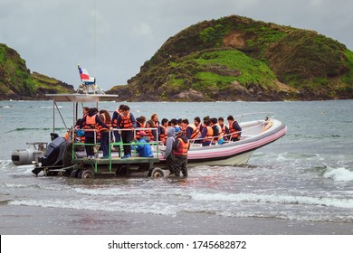 Chiloe Island, Chile - November 15, 2017: Tourists boarding to see penguins in the protected area  Punihuil islets National Monument on the island of Chiloe, Chile