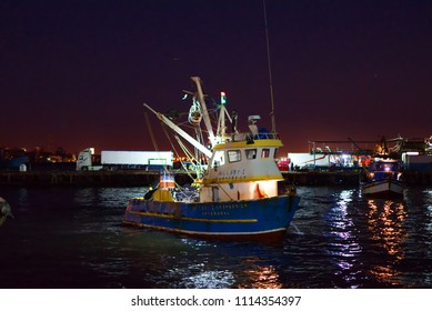 Chimbote, Peru - April 17, 2018: Two trawlers with engines running close to dockside