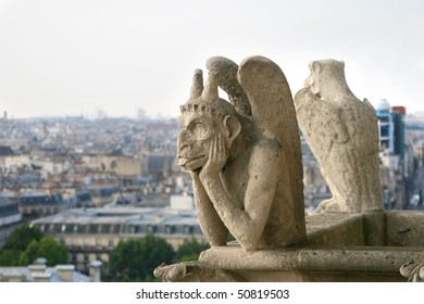Chimera in gothic style is watching over Paris from top of Notre Dame cathedral.