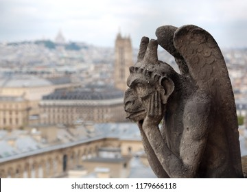 Chimera or grotesque is a fantastic figure used for decorative purposes. This statue is on Basilica of Notre Dame in Paris France