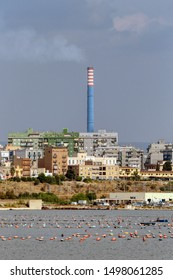 A chimney of ArcelorMittal (formerly Ilva) steel industry above the Tamburi district of Taranto, Puglia, Italy