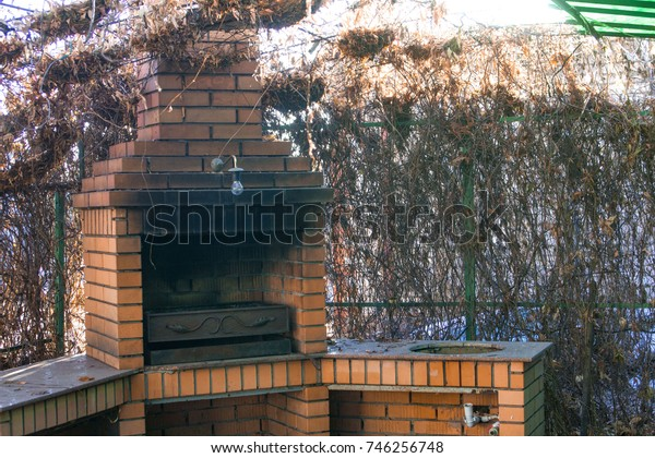 chimney barbecue in a live fence in autumn