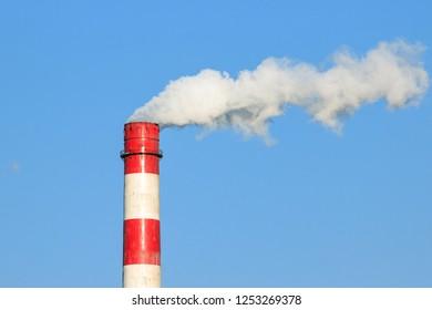 A chimney belching with smoke