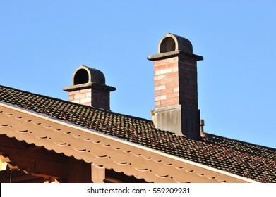 Chimney, built of Brick and Concrete on a tiled Roof, Bavarian Style