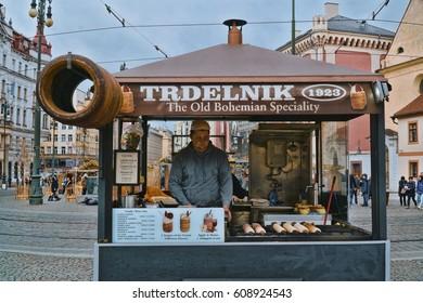 Chimney Cake street sale called Trdlnik in Prague - PRAGUE / CZECH REPUBLIC - MARCH 20, 2017