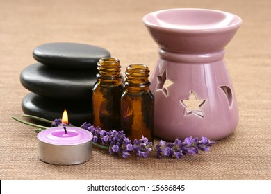 chimney with candle and bunch of lavender