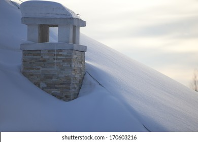 chimney covered by snow in  winter