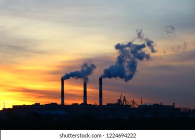 chimney emission on background a sunny dawn