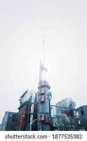 Chimney at heating plant covered in fog, cloudy winter day, low angle view, energy production, air pollution, climate change and global warming concept - Shutterstock ID 1877535382