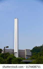 The chimney of the incinerator plant. The abstract concept of air pollution, earth climate warming, greenhouse effect, environment protection and carbon footprint.