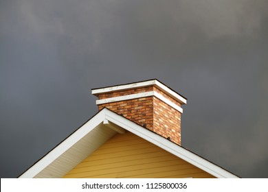 chimney on the roof, the background is the sky, the rain will fall