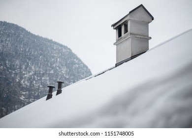 Chimney on roof cover with snow