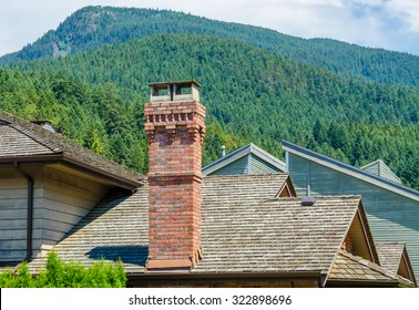 Chimney and pipe on the roof of the house.