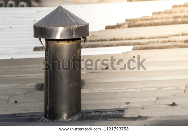 Chimney pipe from stainless steel on the roof of the house. Rusty up the pipes