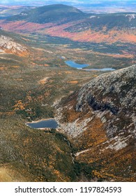 Chimney Pond, the view from atop Mount Katahdin Baxter Peak in Millinocket ME. This gorgeous valley has lots of colorful leaves of autumn.