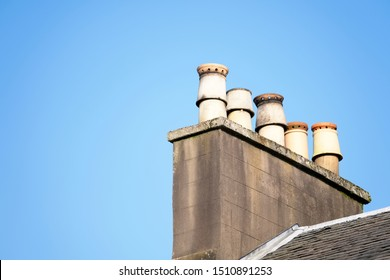 Chimney pots on old victorian house roof uk