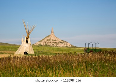 chimney rock national historic site.  It  is a prominent geological rock formation in western Nebraska, rising nearly 300 feet above the surrounding North Platte River valley