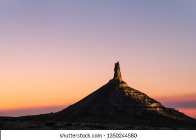Chimney Rock National Historic Site illuminated at night, western Nebraska, USA. The peak of Chimney Rock is 1289 meters above sea level.