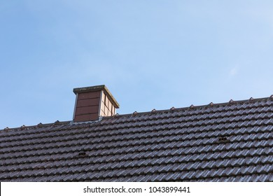 chimney roof house with blue sky