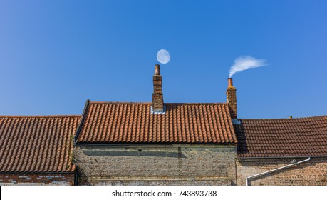 chimney roof line with moon and smoke
