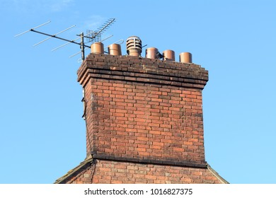 Chimney stack and tv aerial on roof of Victorian style property