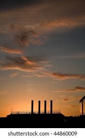 chimney with a  warm orange sun in denmark