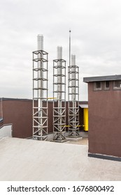 Chimneys and ventilation system of an industrial gas boiler on the roof of a building.
