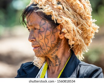 CHIN PEOPLE, MYANMAR – 16 FEBRUARY 2019: Portrait of an old Chin woman in traditional dress with a tattoo on her face. 16 February, 2019, Myanmar.
