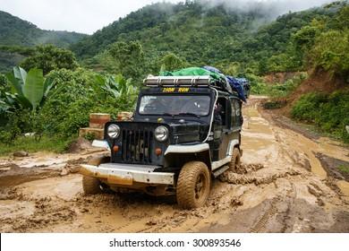 CHIN STATE, MYANMAR - JUNE 22 2015: Offroad Adventure on Dirt Road Leading Through Chin State Mountainous Region, Myanmar (Burma)