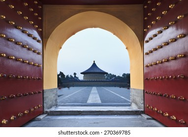 China, Beijing' Garden of Heaven - residency of ancient chinese emperors. Red-gold imperial gates wide open towards round temple