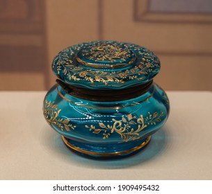 CHINA BEIJING - October 3, 2017: Green Glass Can with Golden pattern with Lid. Ancient China Qing Dynasty.