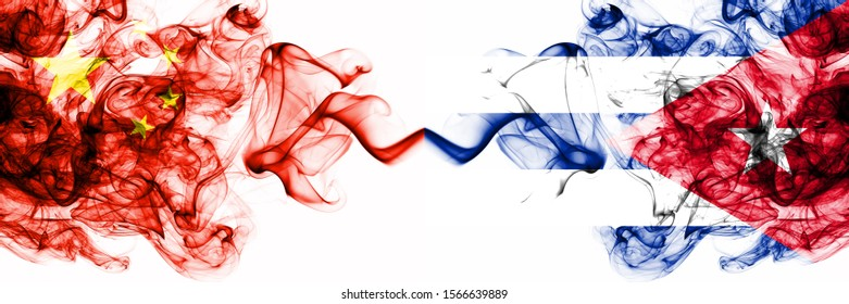 China, Chinese vs Cuba, Cuban smoky mystic states flags placed side by side. Concept and idea thick colored silky abstract smoke flags