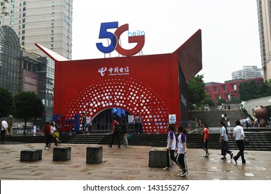 China, Chongqing – June 17, 2019: 5G Technology is the new trend in China. The pop up exhibition from China Telecom and 3D logo displays in front of PARK 108 Shopping Center at Jie Fang Bei Time Squar