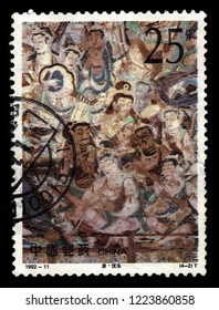 CHINA - CIRCA 1992: A stamp printed in China shows ancient frescoes in the Mogao Caves, also known as the Thousand Buddha Grottoes or Caves of the Thousand Buddhas, Dunhuang, Gansu, China, circa 1992