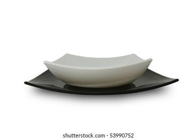 China dinner service. White and black empty plates.