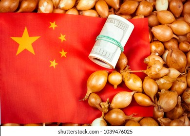 China flag on the onions and the roll dollars. Export of onions from the China