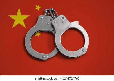 China flag  and police handcuffs. The concept of observance of the law in the country and protection from crime