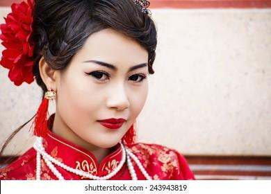 China Girl ,Chinese woman red dress traditional cheongsam ,close up portrait