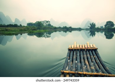 "China Guilin Yangshuo bamboo rafting in the beautiful ""Yulong River"" retro colors."