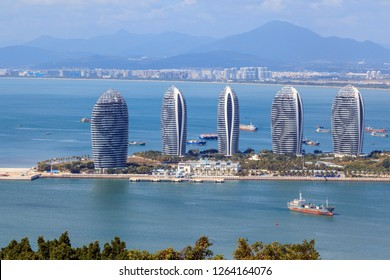China, Hainan Island, Pheonix Island  - December 2, 2018: Pheonix Island Sanya, illuminated buildings.Orange Bronze, Unique modern design. Phoenix island sanya, is a chinese marvel, editorial